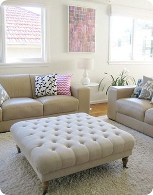 DIY tufted Ottoman.  Adding this to the list of possible solutions for our living room!