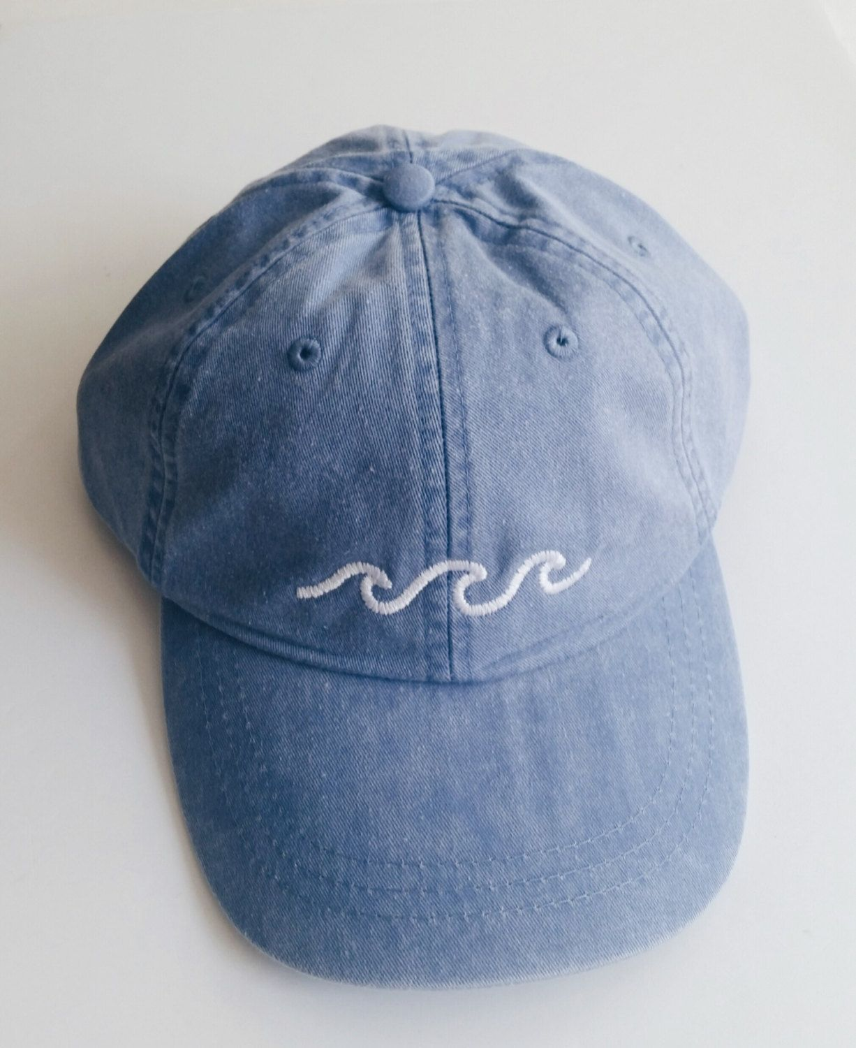 The perfect embroidered baseball cap with a simple three wave design. One  size fits all 3420b99f8b16