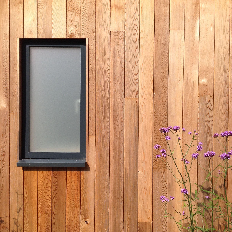 Powder coated aluminium windows set inside timber clad for Window cladding