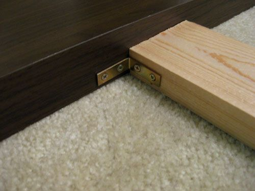 Aha. How to attach legs to your DIY headboard. (Then frame attaches to 2x4s.)