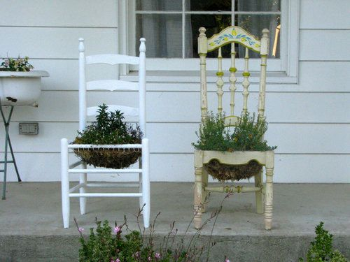 Old chair planters, now where are they?? hmm. . . . .