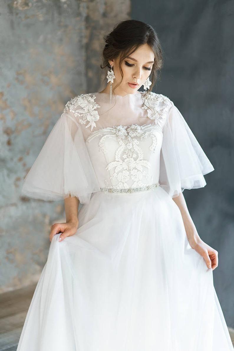 Avrelia pearl wedding dress with rich beautiful hand