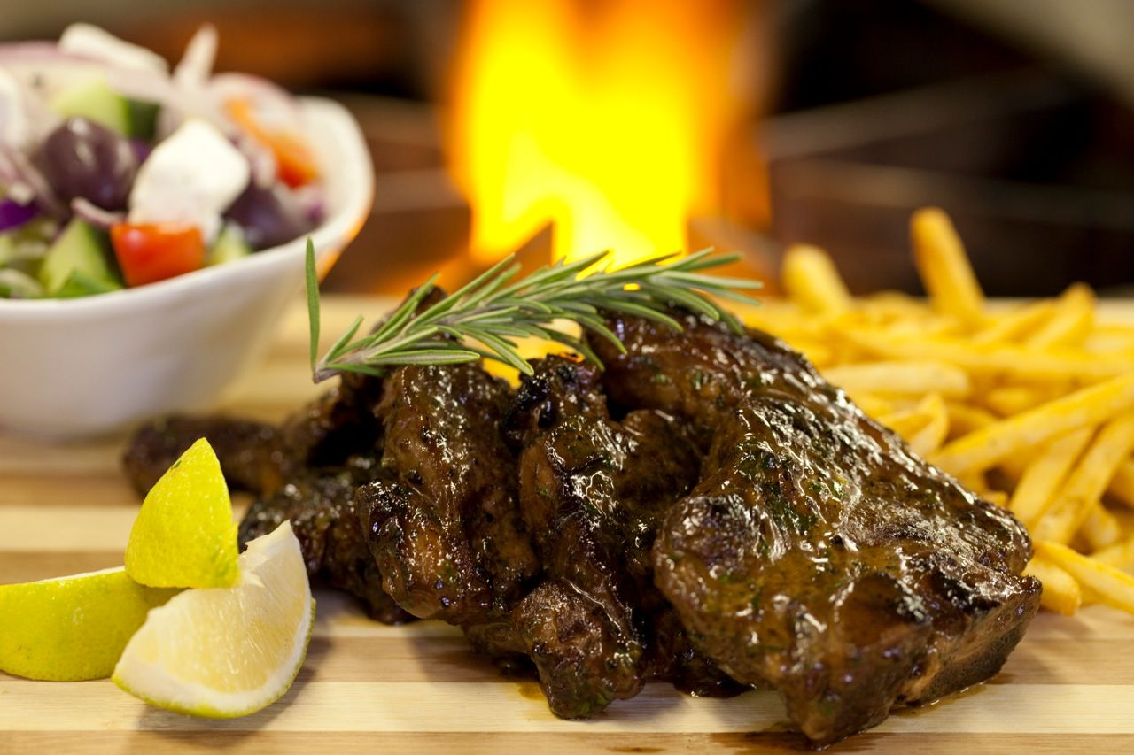 Lamb Chops: Loin chops flame-grilled & simmered in lemon, garlic,white wine & cream. Served with a small Greek salad & seasoned shoestring fries.