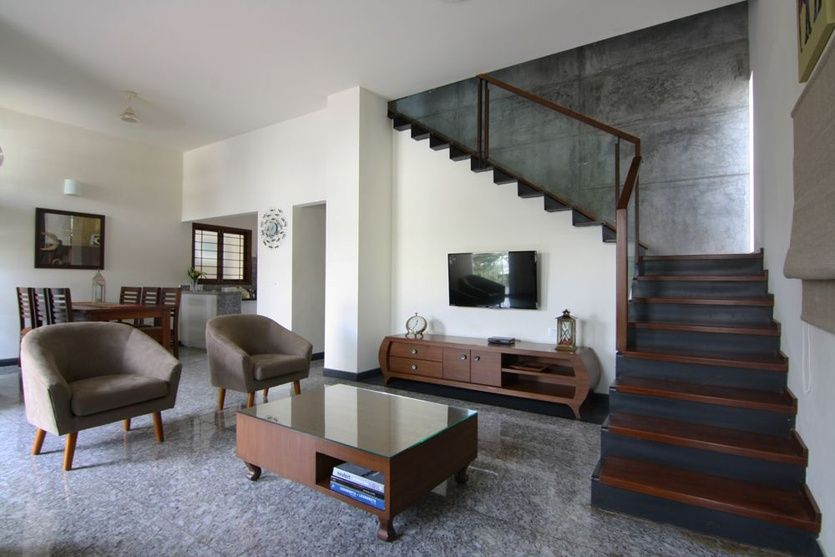 Living room with granite flooring tiles design by kamat for Living room interior bangalore