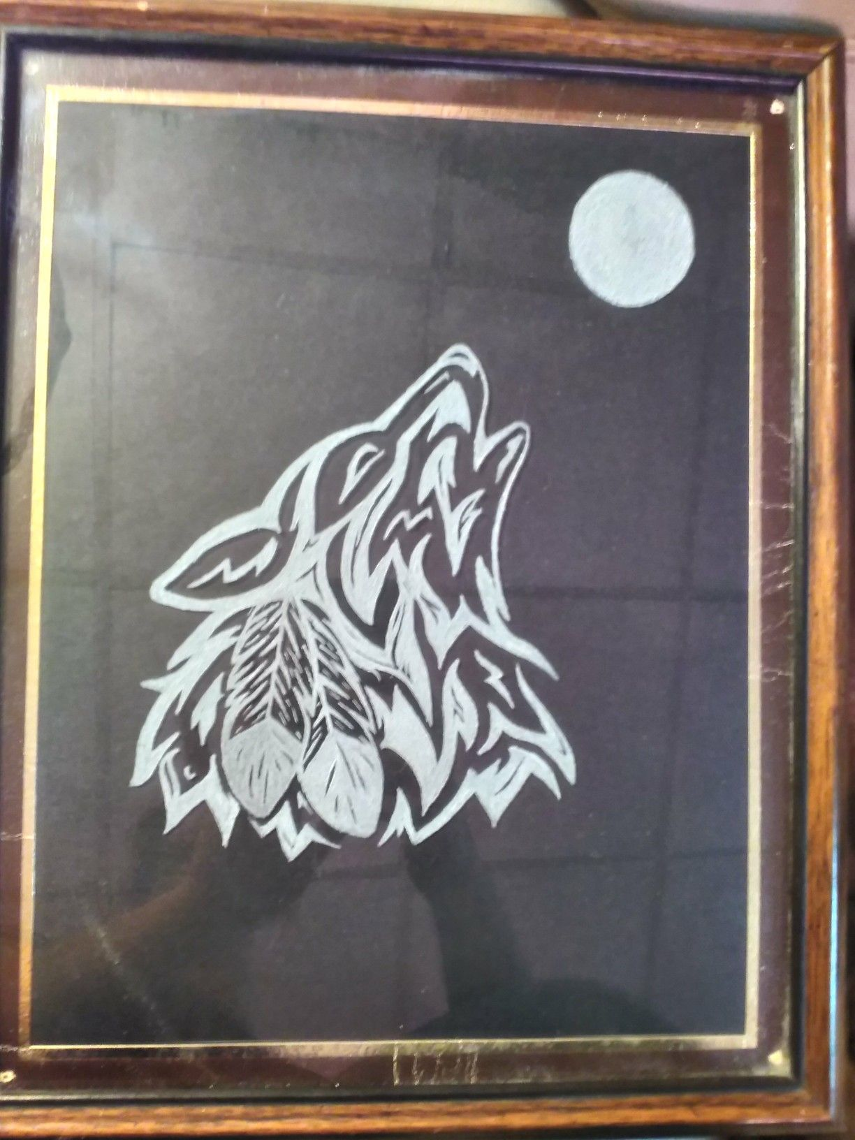 I etched a trible wolf and moon on the glass of a picture frame ...