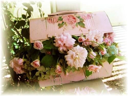 Old lunch pail made into a beautiful arrangement.