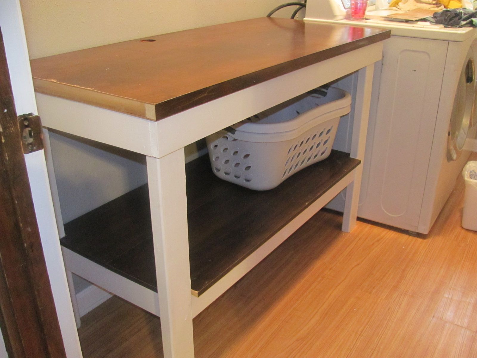 laundry room table with storage