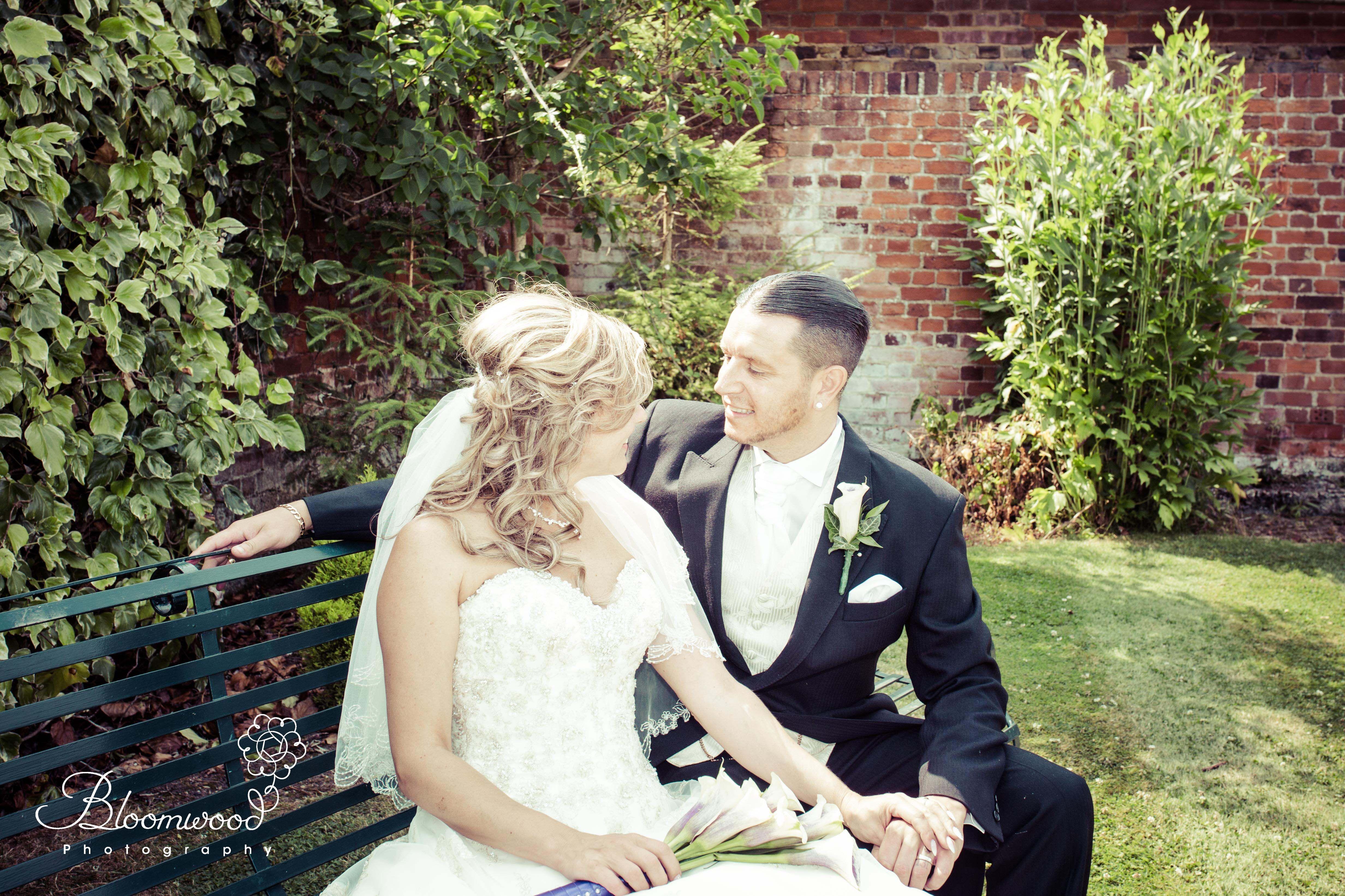 Beautiful bride & groom having a precious moment together ...