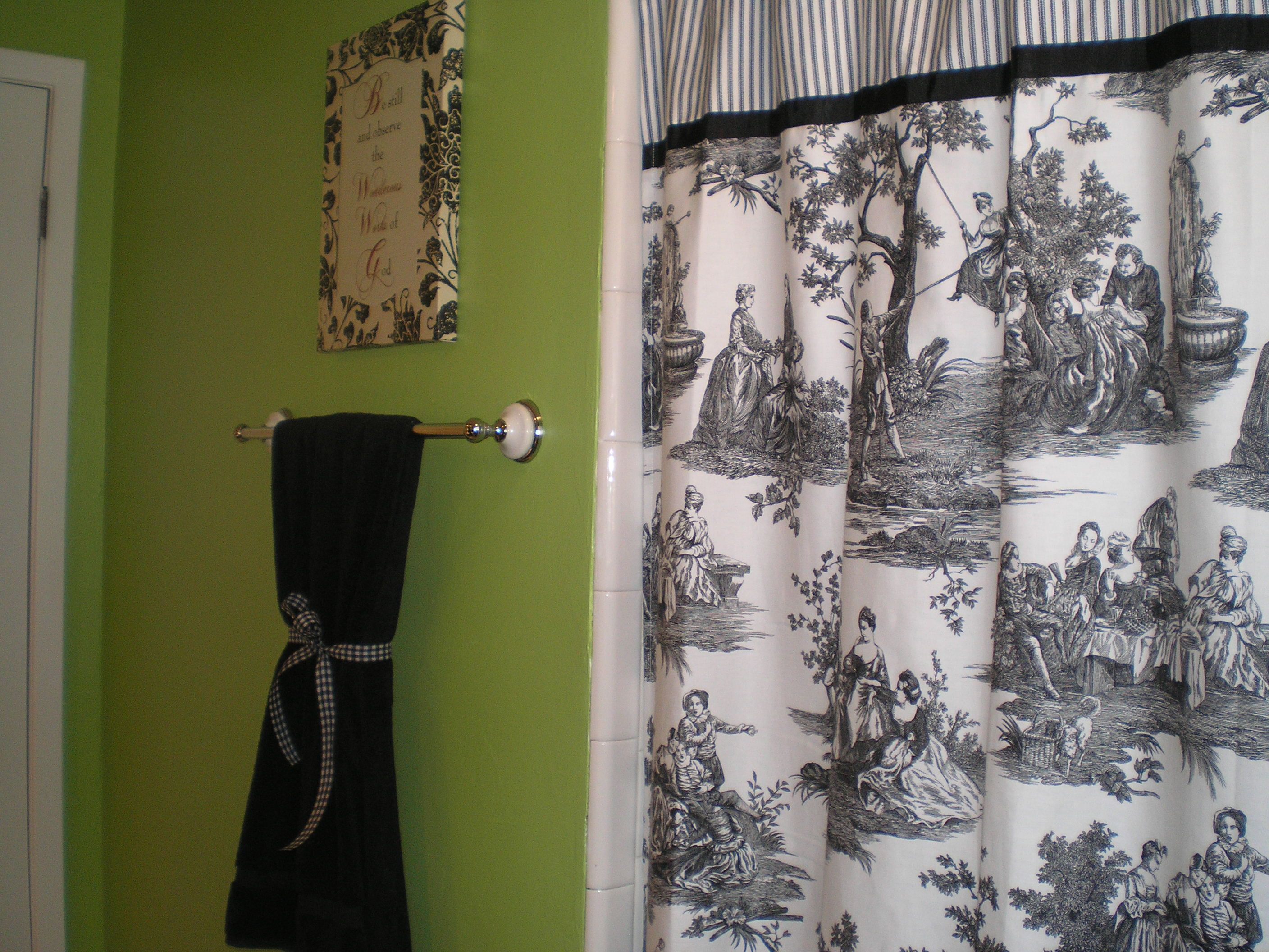 Lime green bathroom with black, white and red accents. The toile ...