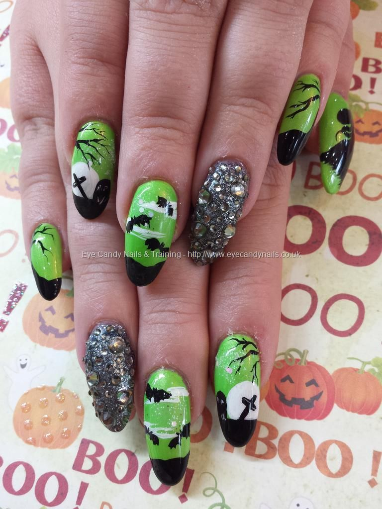 Green and black halloween nail art over acrylic nails