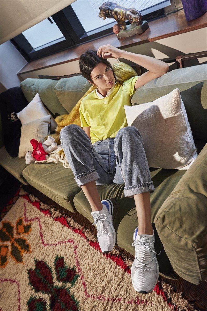 online retailer 1b1e6 4a80d Posing on a couch, Kendall Jenner wears adidas Originals Arkyn sneaker