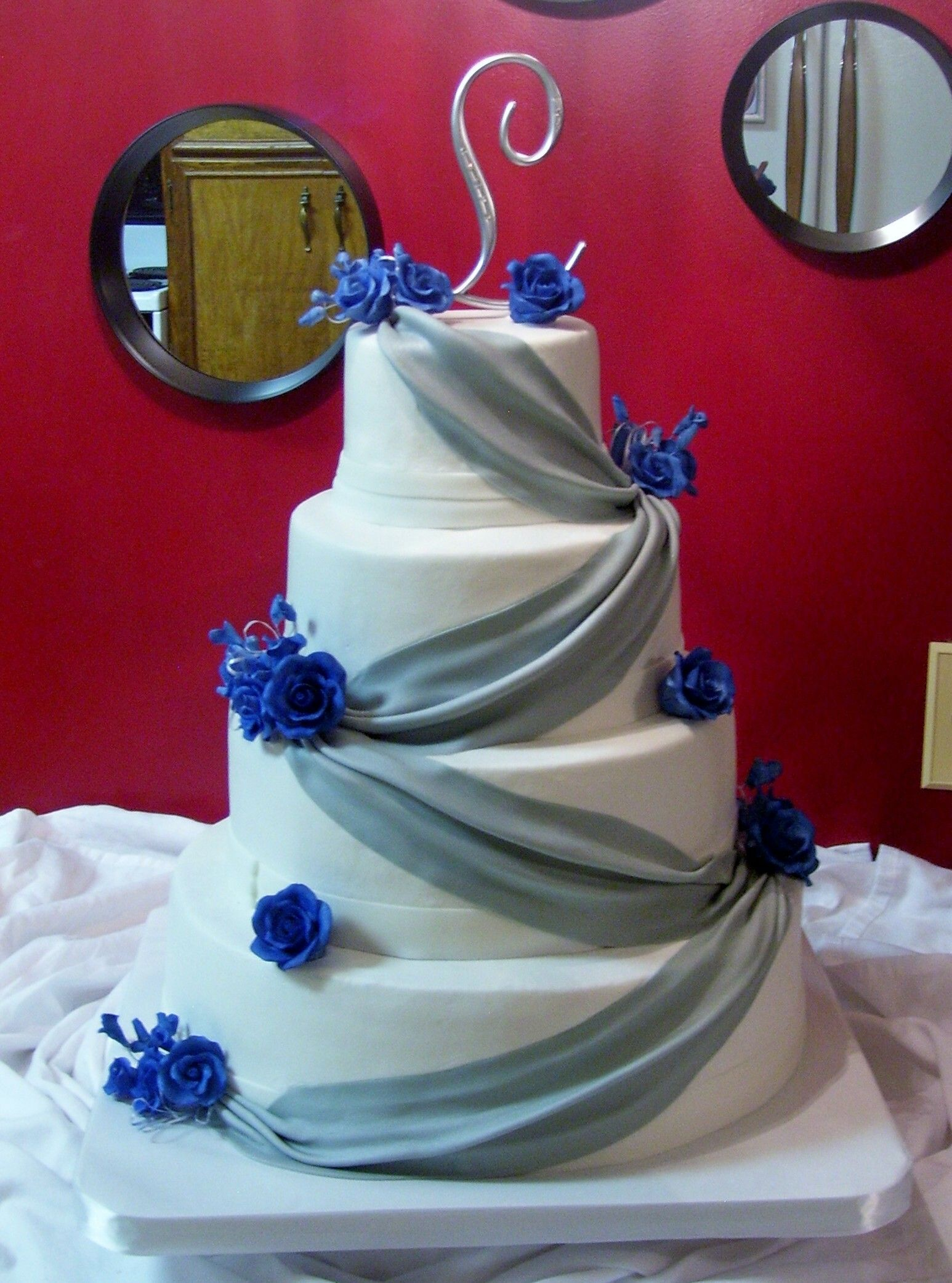 Royal Blue and Silver Four tier wedding cake 5 8 11