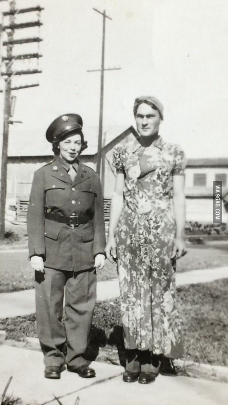 Grandparents wearing each other's clothes. (1943)