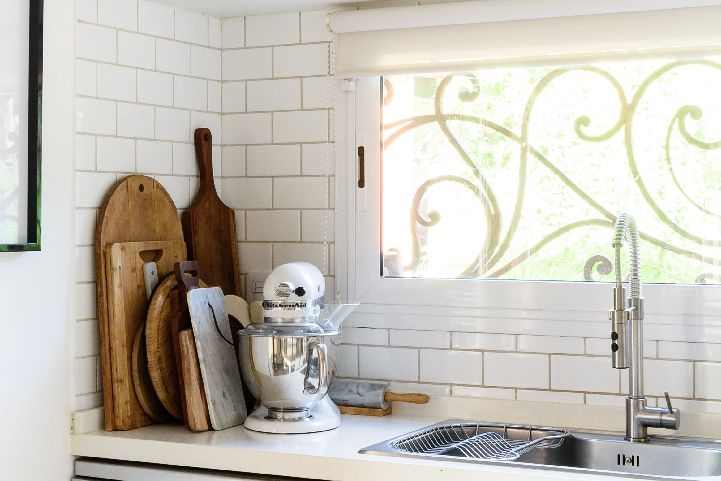 Shelf across kitchen window  tour a family of sixus cozy renovated buenos aires home  long