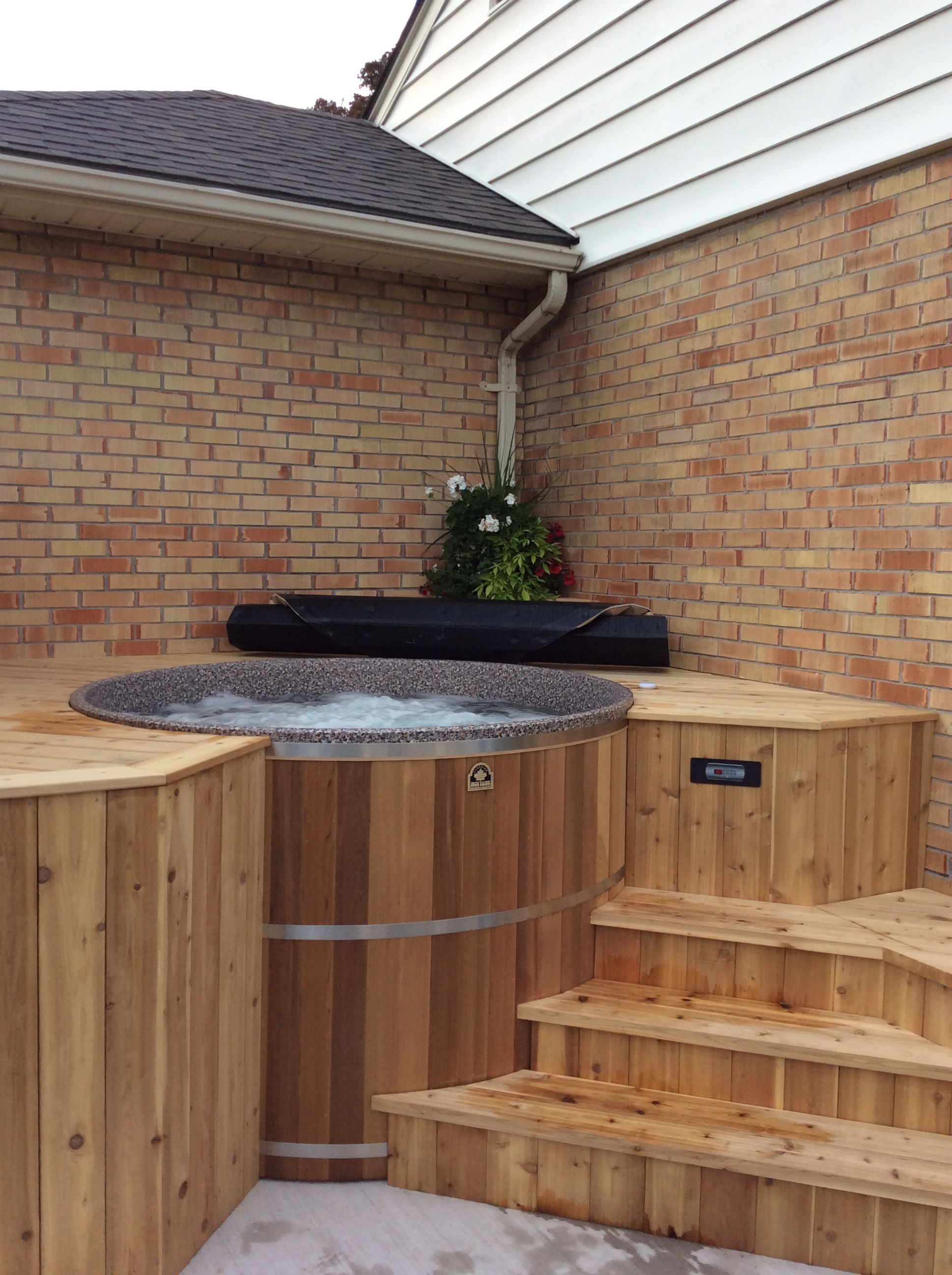 The addition of a cedar hot tub from Canadian hot Tubs