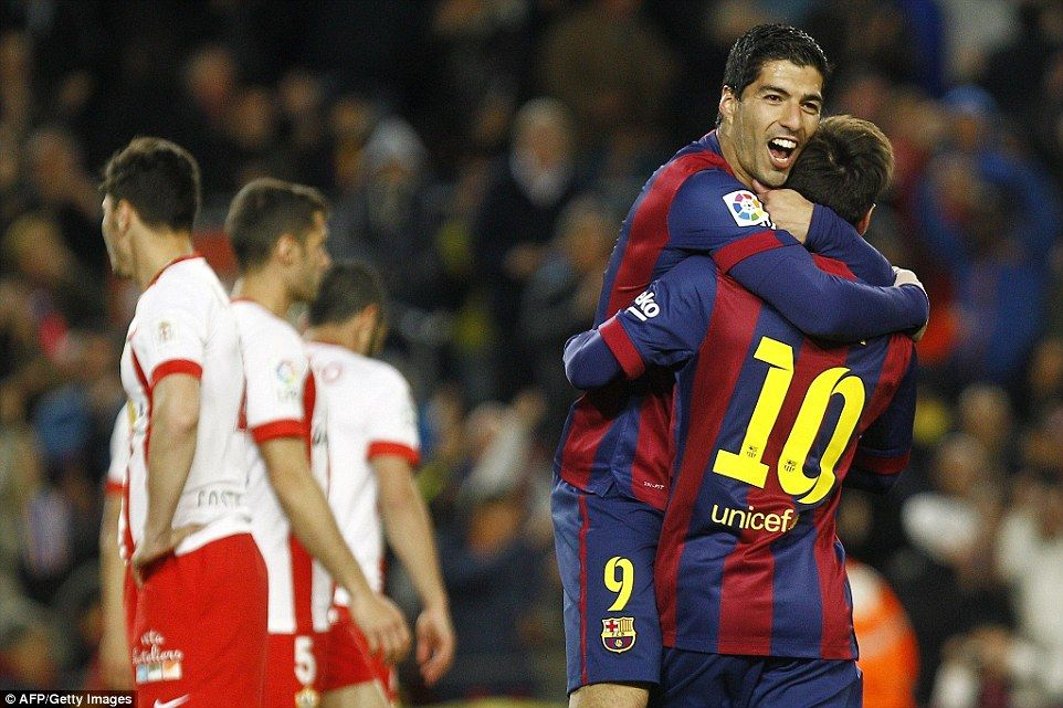 Suarez leaps into Messi's arms after the pair's sensational opening strikes put the hosts in control