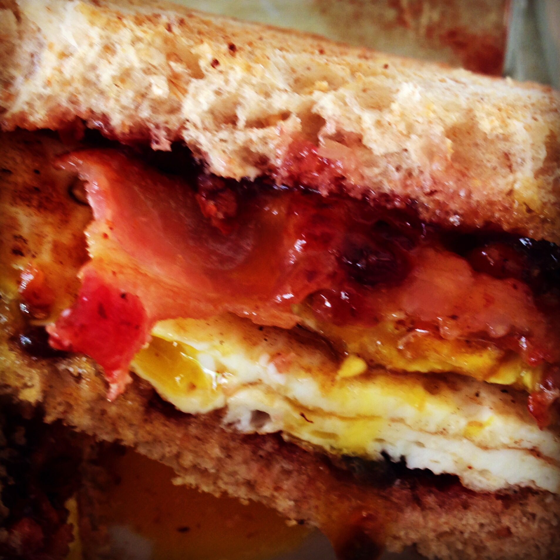 The Maritimer Breakfast Sandwich--           2 over easy eggs, 3 strips bacon, 2 pieces toast, butter and jam on the toast. Put the eggs and bacon between the toast ! It's so simple and so good!!!