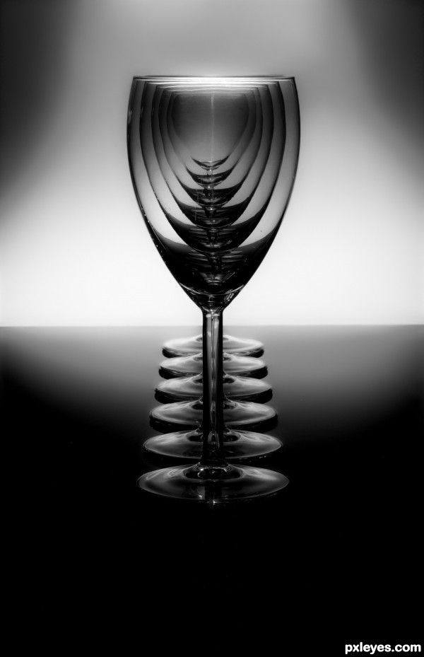 Such an odd image. I can't tell if its distorted in the glass or if it would simply appear this way with how everything is positioned. I want to draw it, but I can't imagine the doing the multiple layers of value formed by overlapping glasses.
