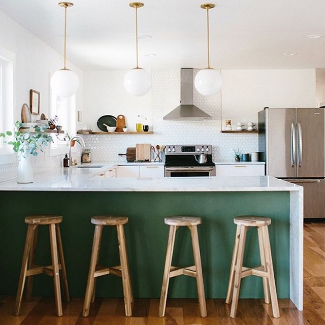 The waterfall counter, that pop of hidden color under the bar, the bright open space!  I am so in love with @annabode 's kitchen!  What do you love about it?  Get featured use #imaremodelaholic
