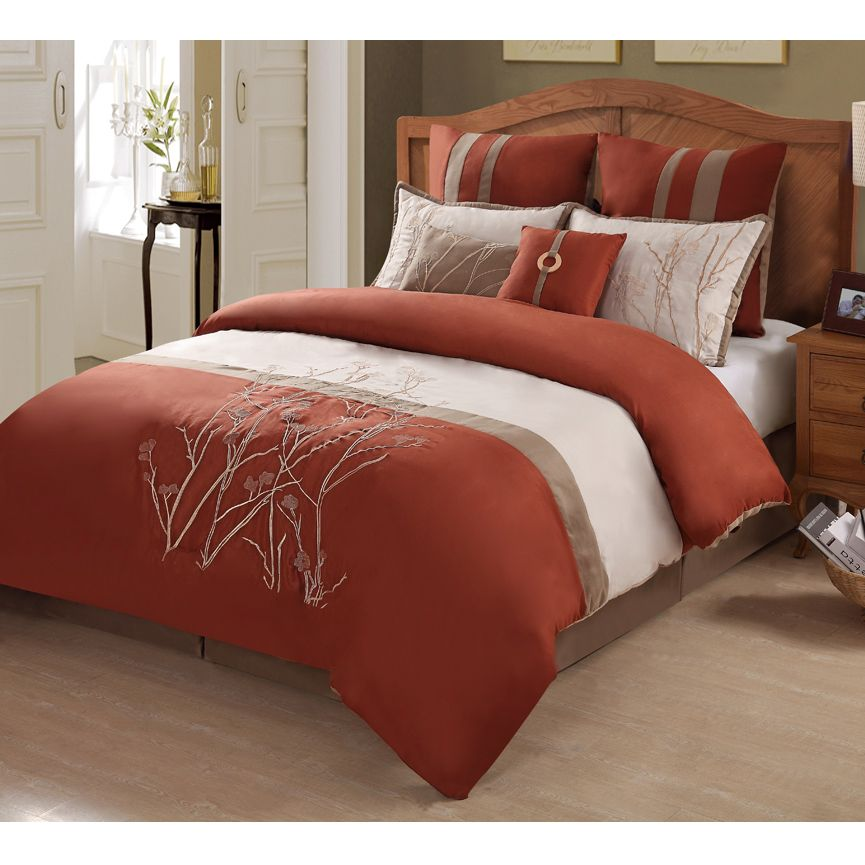 Embroidered vines on a color block background makes this comforter ...