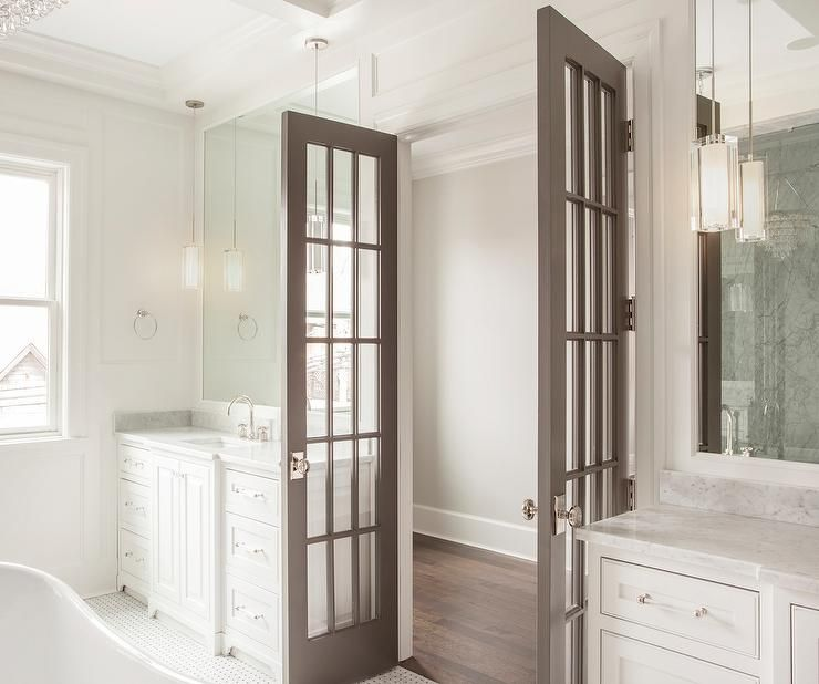 Gray French Doors Open To A Master Bathroom Filled With