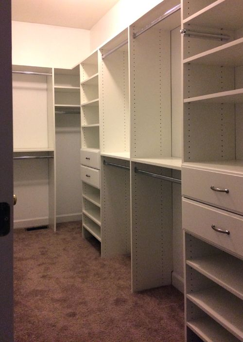 Storage System For A Long Narrow Closet That Has Rods For Hanging