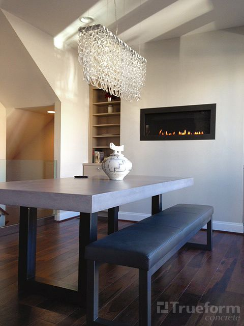 contemporary zen dining table with a metal base and concrete dining table top trueformconcrete. Black Bedroom Furniture Sets. Home Design Ideas