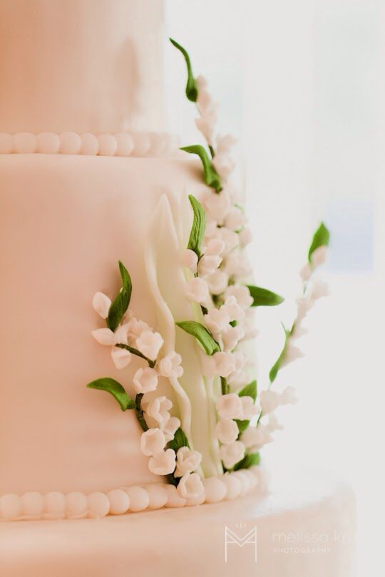 Lily of the valley sugar flowers on cake. Simple and elegant.