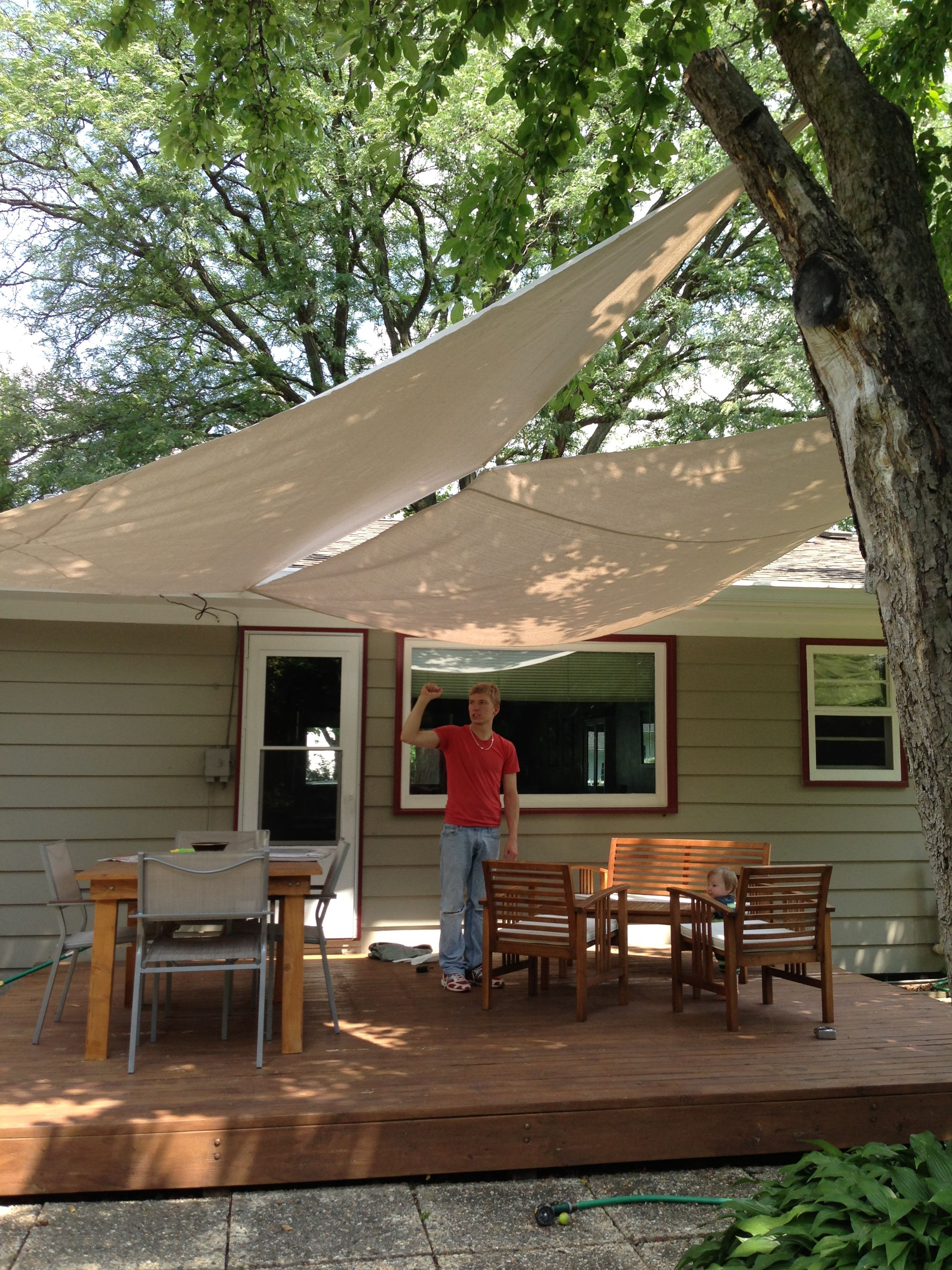DIY Deck Awning With Painters Drop Cloth Canvas Grommets And Eye Screws