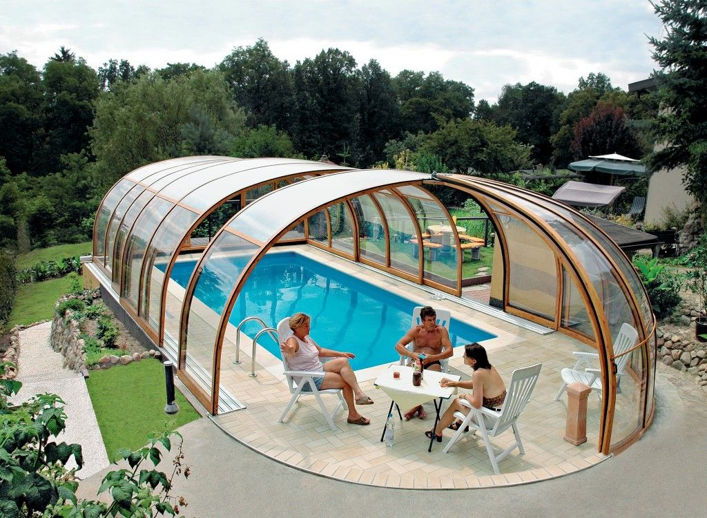 High Height Pool Enclosure Offers Space For People To Sit At A Table Pool Enclosures Indoor Pool Design Swimming Pool Pond