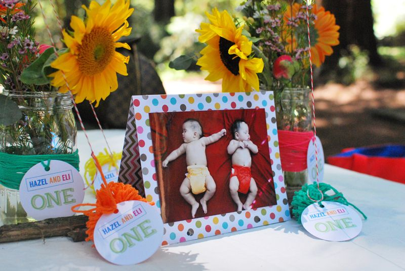 Adorable, personal and colorful centerpieces for a kids' birthday party. See these twins' 1st birthday party on jforjamie.com.