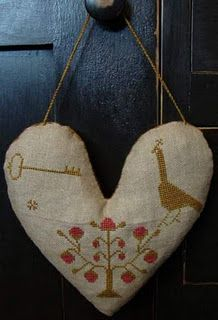 A cross stitched heart