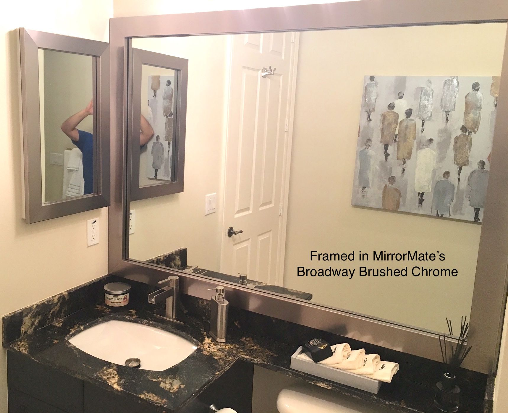 a mirrormate frame was added to both the existing wall mirror and the medicine cabinet on - Mirrormate Frames