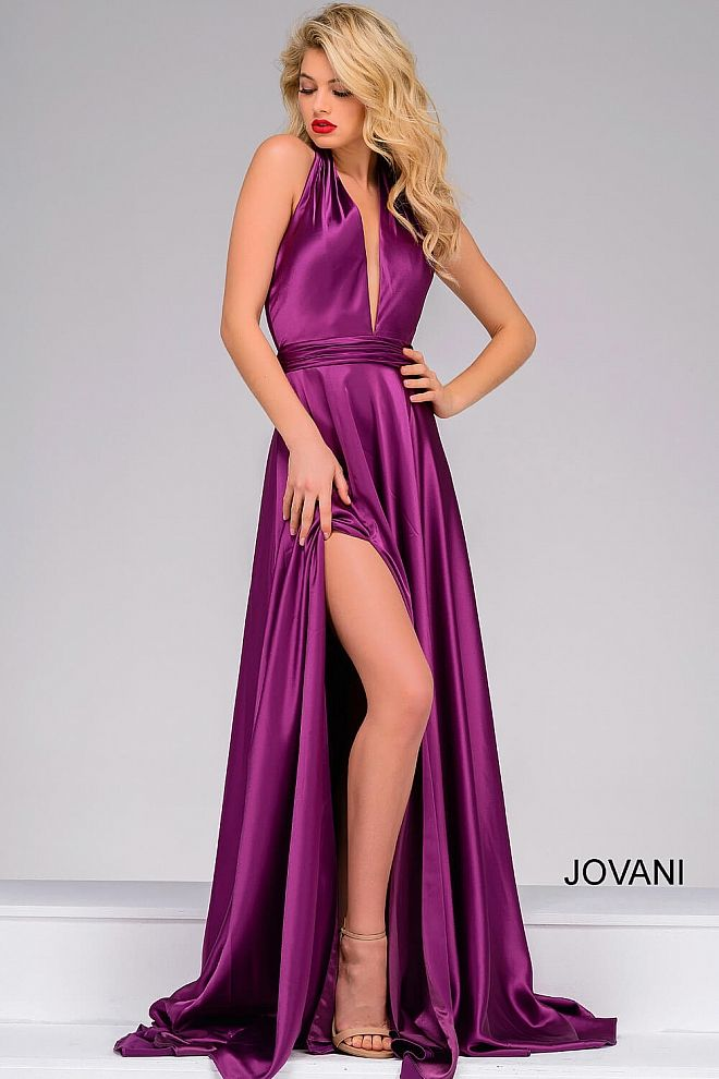 b4bd047ca3c Classy floor length flowy purple satin prom dress with high slit features  sleeveless bodice with plunging v halter neck and open back.