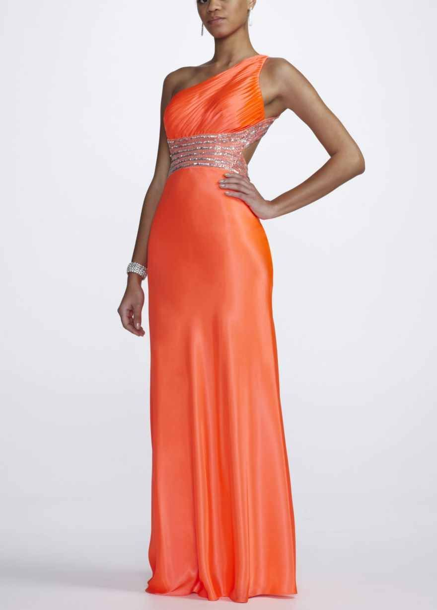 One shoulder orange dress with silver accents and plunging back