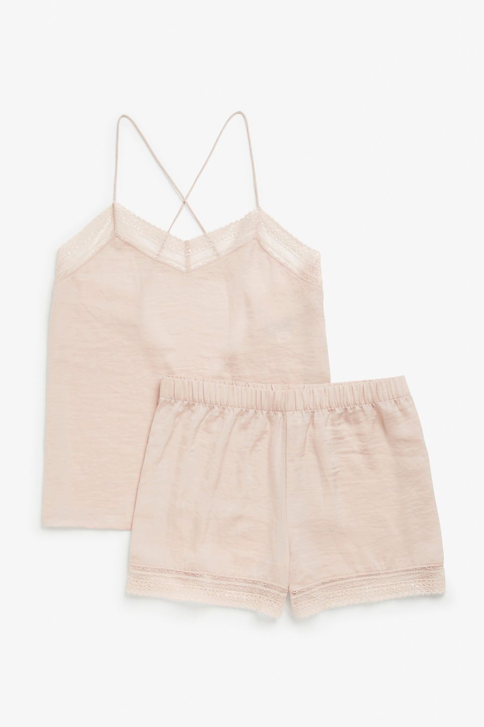 41996c40562 This silky-soft pyjama set with spaghetti straps is a dream come tru. The  top is laced in the front and the shorts are laced at the bottom.