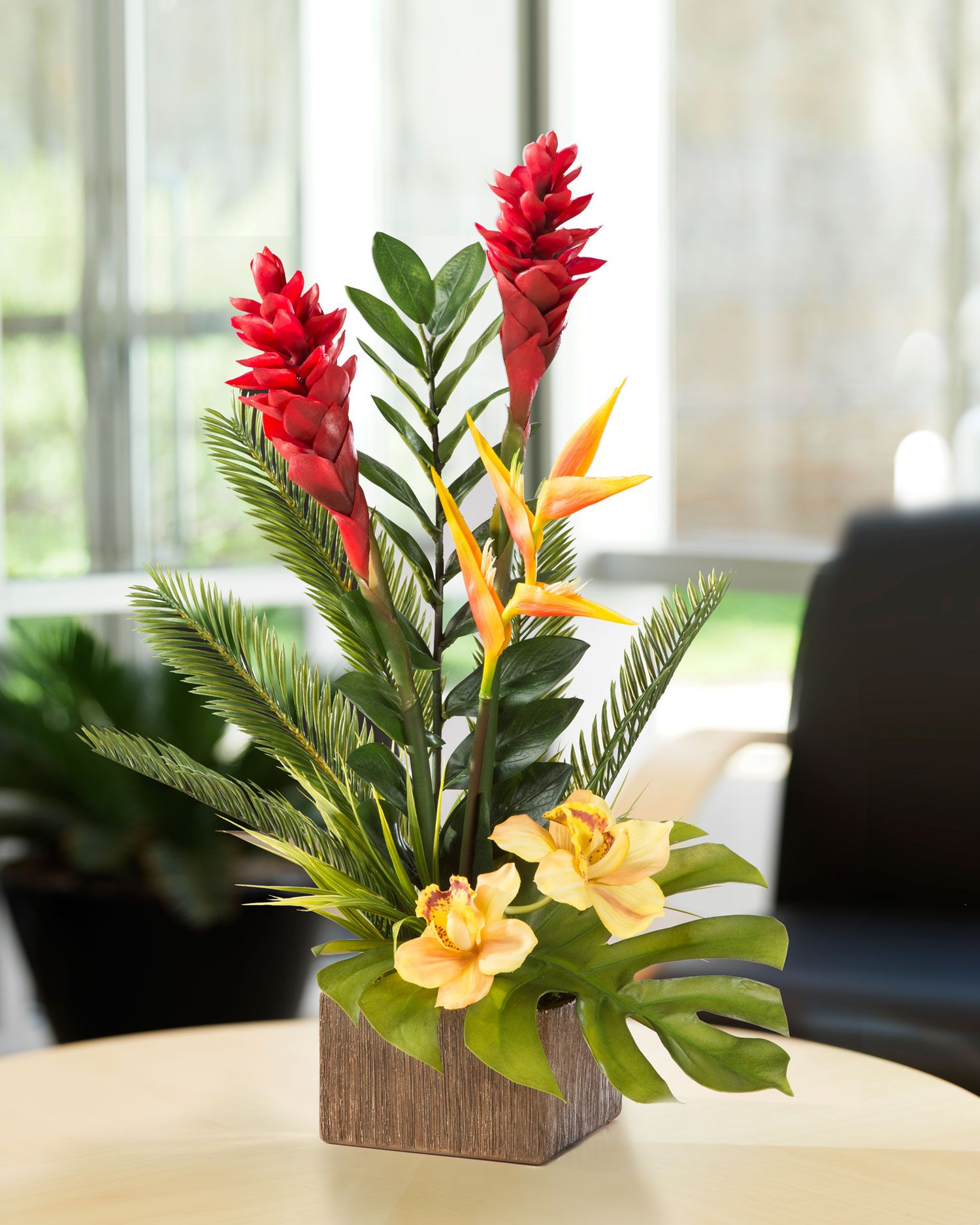 Exotic torch ginger and orchid arrangement with bird of