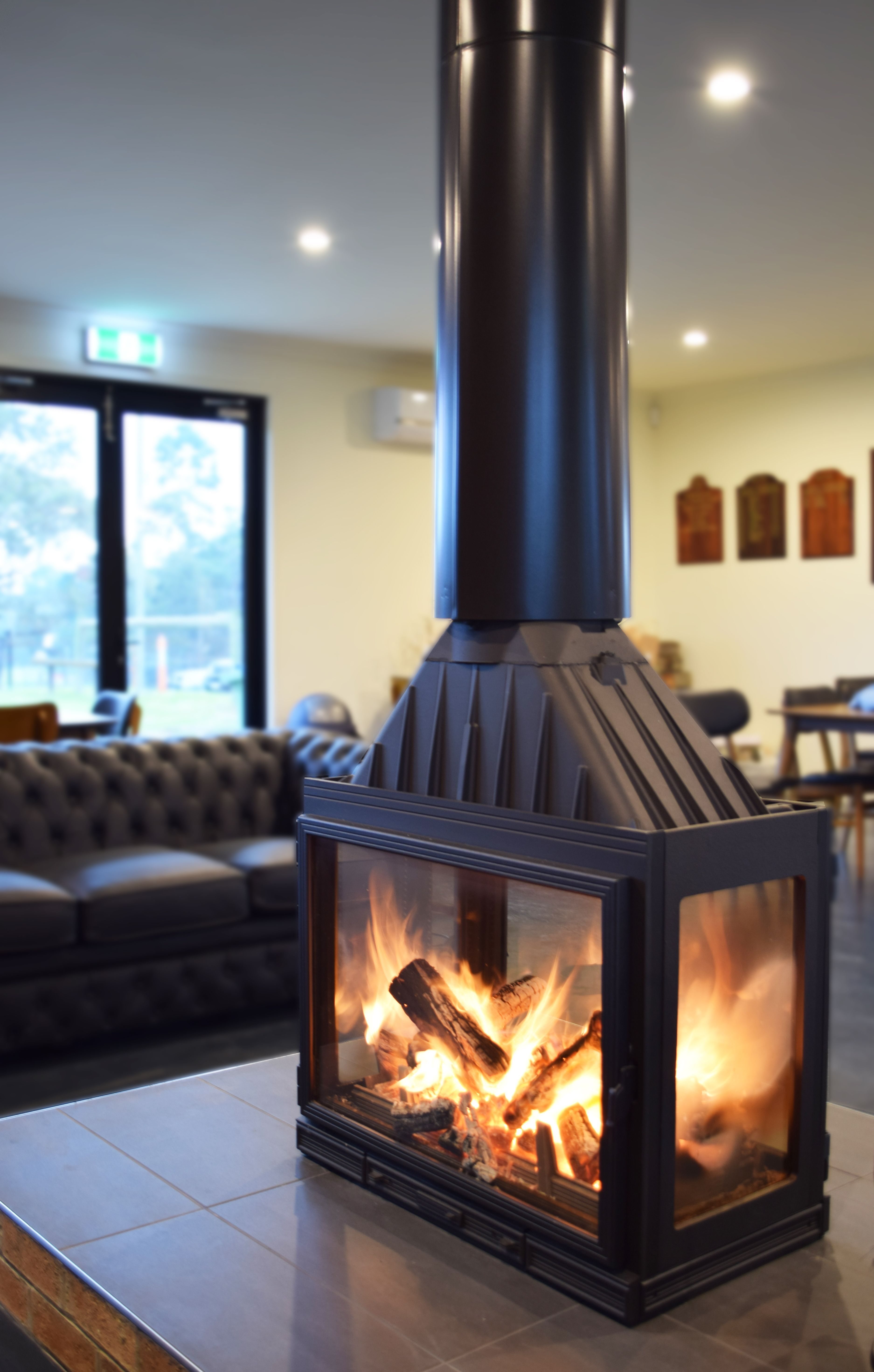 Australia S First Four Sided Wood Heater Beautiful From All Angles With Its Pure Cast Iron Construction T Wood Heater Freestanding Fireplace Glass Fireplace
