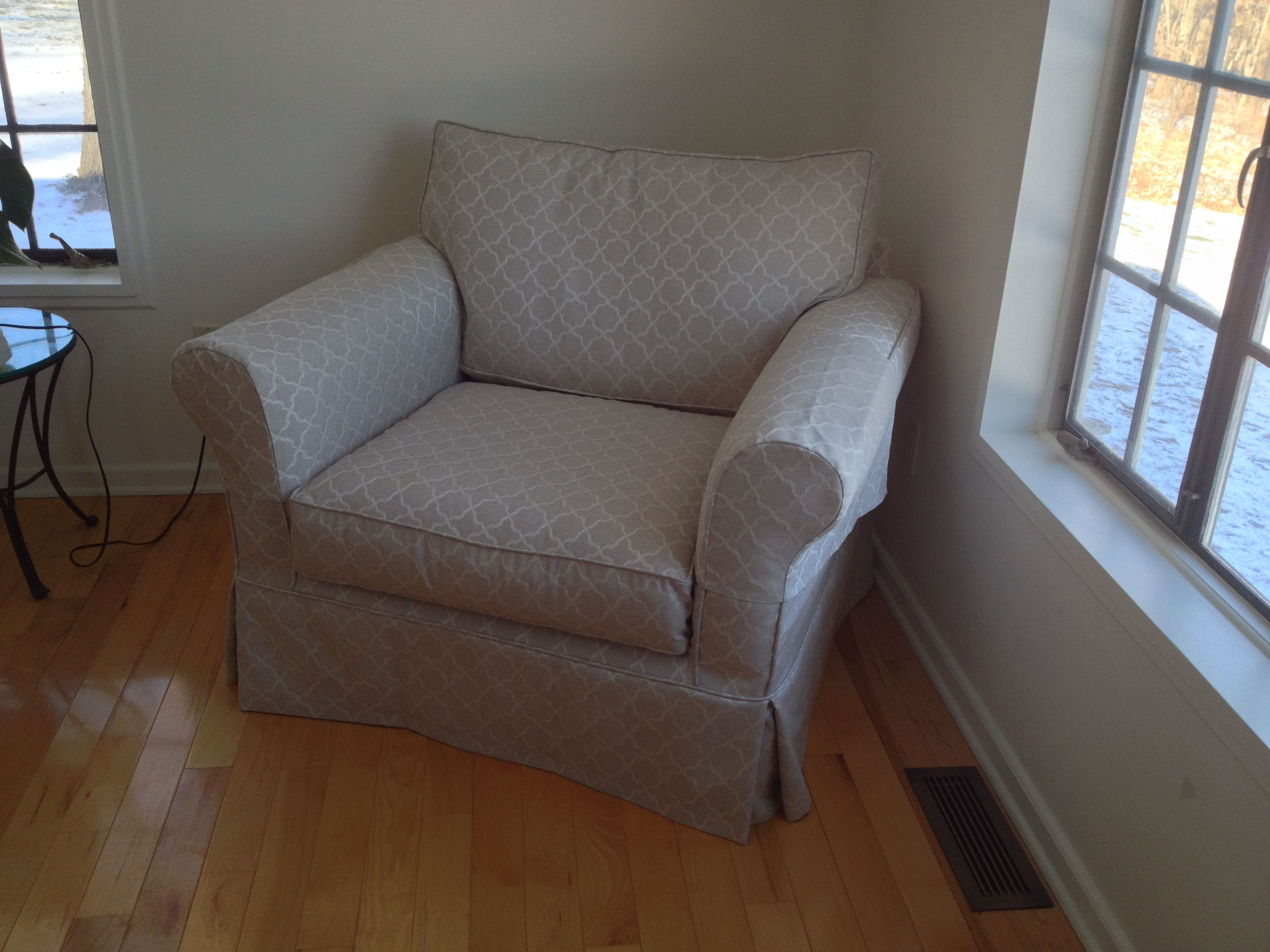 Club chair slipcover with arm covers fabricated from the same