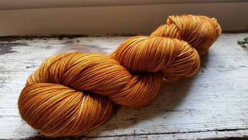 A deep, rich pumpkin and burnt orange color making this yarn a