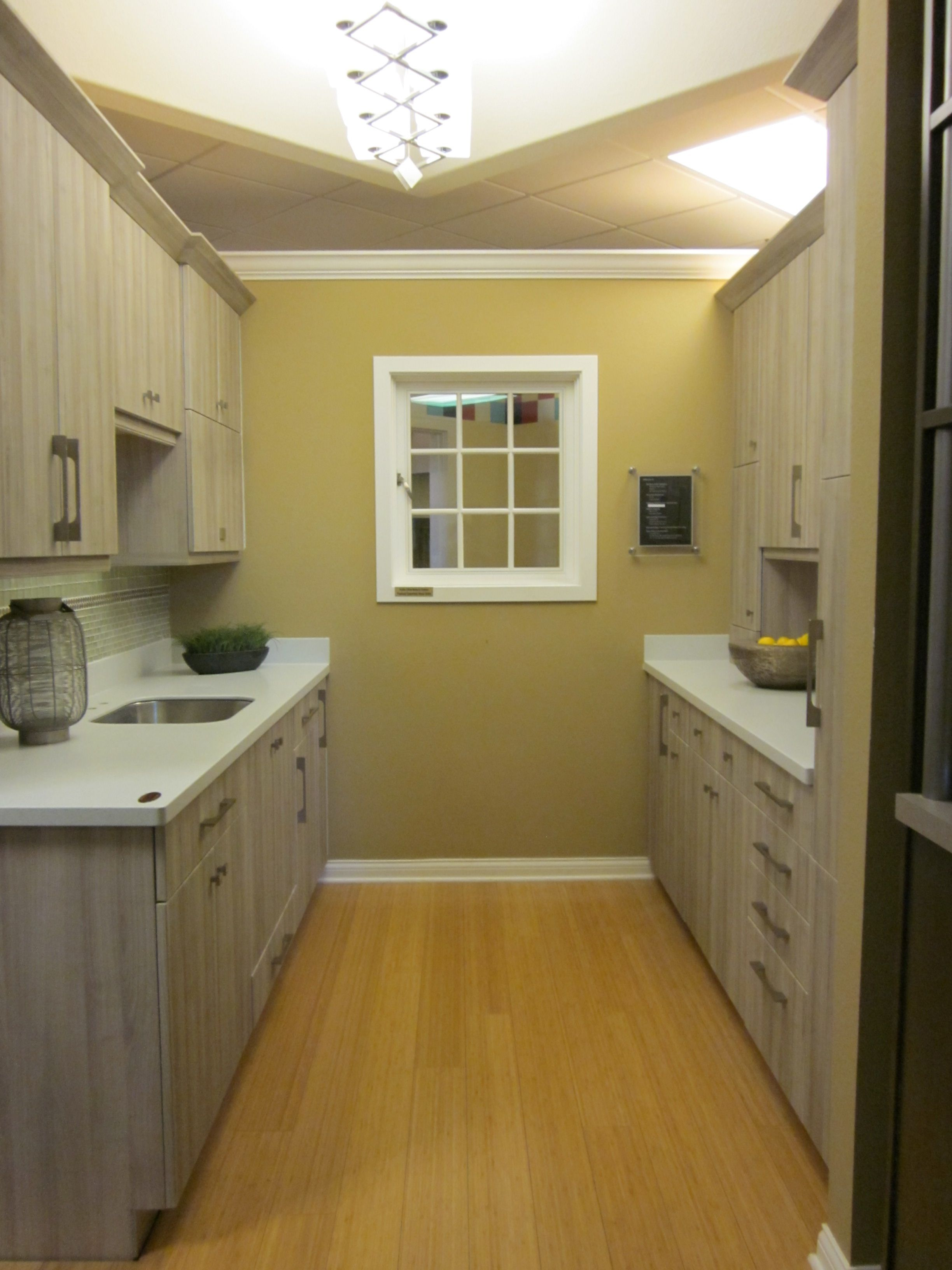 Dress up a galley kitchen with Kitchencraft cabinetry. This ...