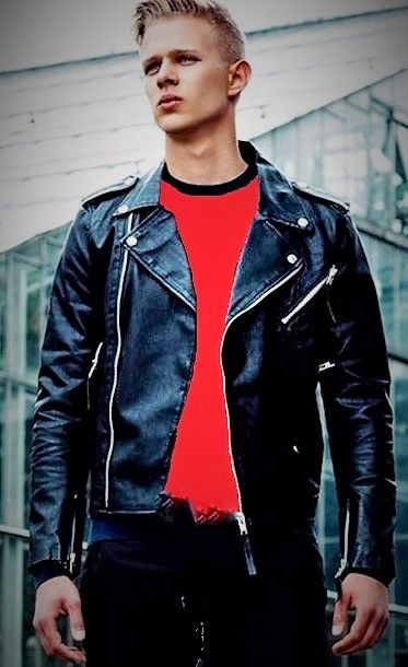 Blond boy with classic biker jacket and red tee shirt ...