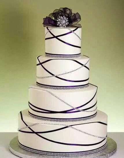 Lovely four layered round cake trimmed with rhinestones and purple ...