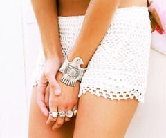 OMG I want all of this. skirt, jewelry, the tan...