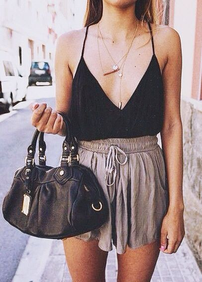 Street style outfit, skirt and black top finished off with accessories