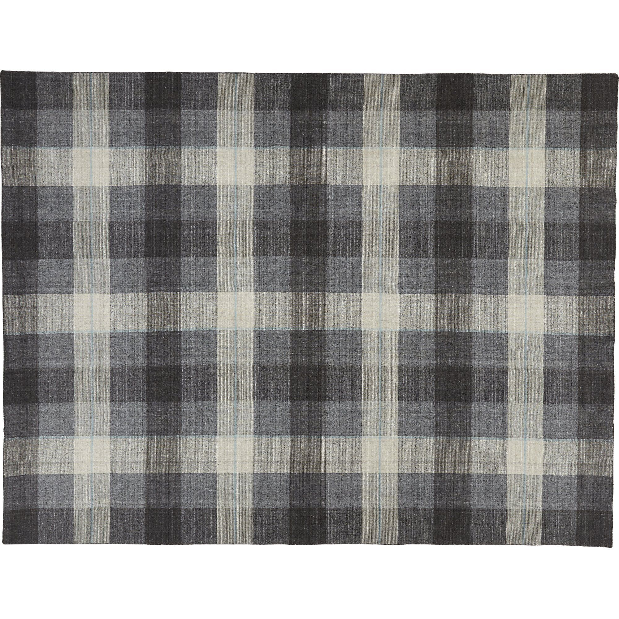 Shop tailor plaid rug.   Like a fine tailored suit turned rug.  Classic plaid is made modern in tonal neutrals and a pinstripe of blue.  Hand-loomed flatweave with semi twisted yarn adds welcoming texture to any room.
