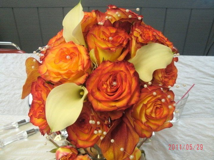 This was my bridal bouquet of Circus Roses and white calla lilies, I made this bouquet myself.
