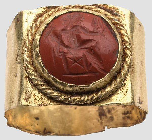Gold ring with gem, Roman, 2nd Century. AD Round cabochon of red jasper with sectional representation of the seated Fortuna, in the hands of cornucopia and ears of wheat.