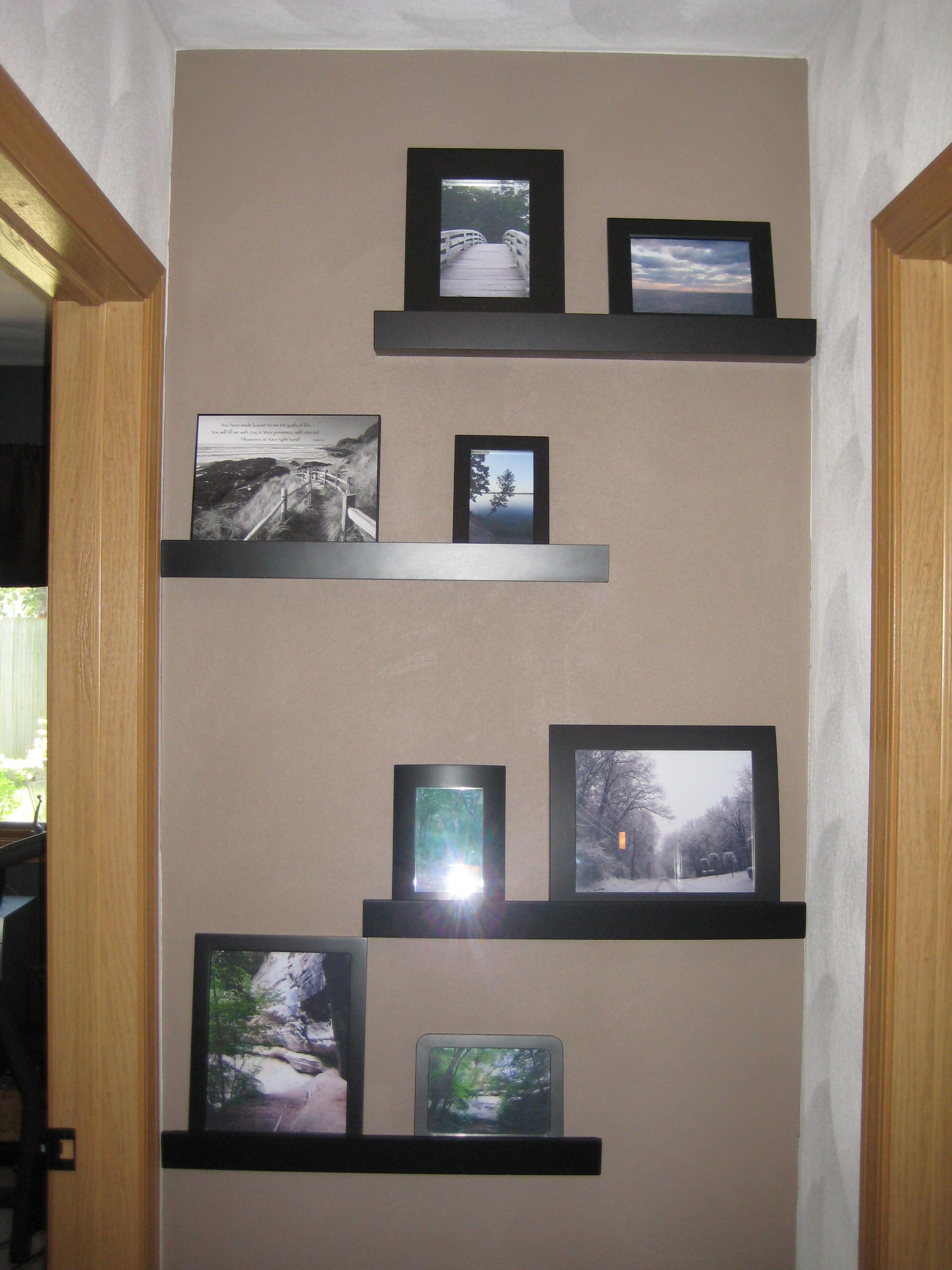 Brighten the end of a hallway with staggered shelves and a different