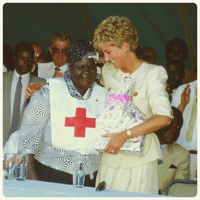 """""""12 July 1993: Princess Diana visit the Tgongora and the Nemazura refugee camps in Zimbabwe to observe the Red Cross Children Feeding Scheme, a project aimed at supplying nutritious meals for children at the Nemazuva Primary School"""